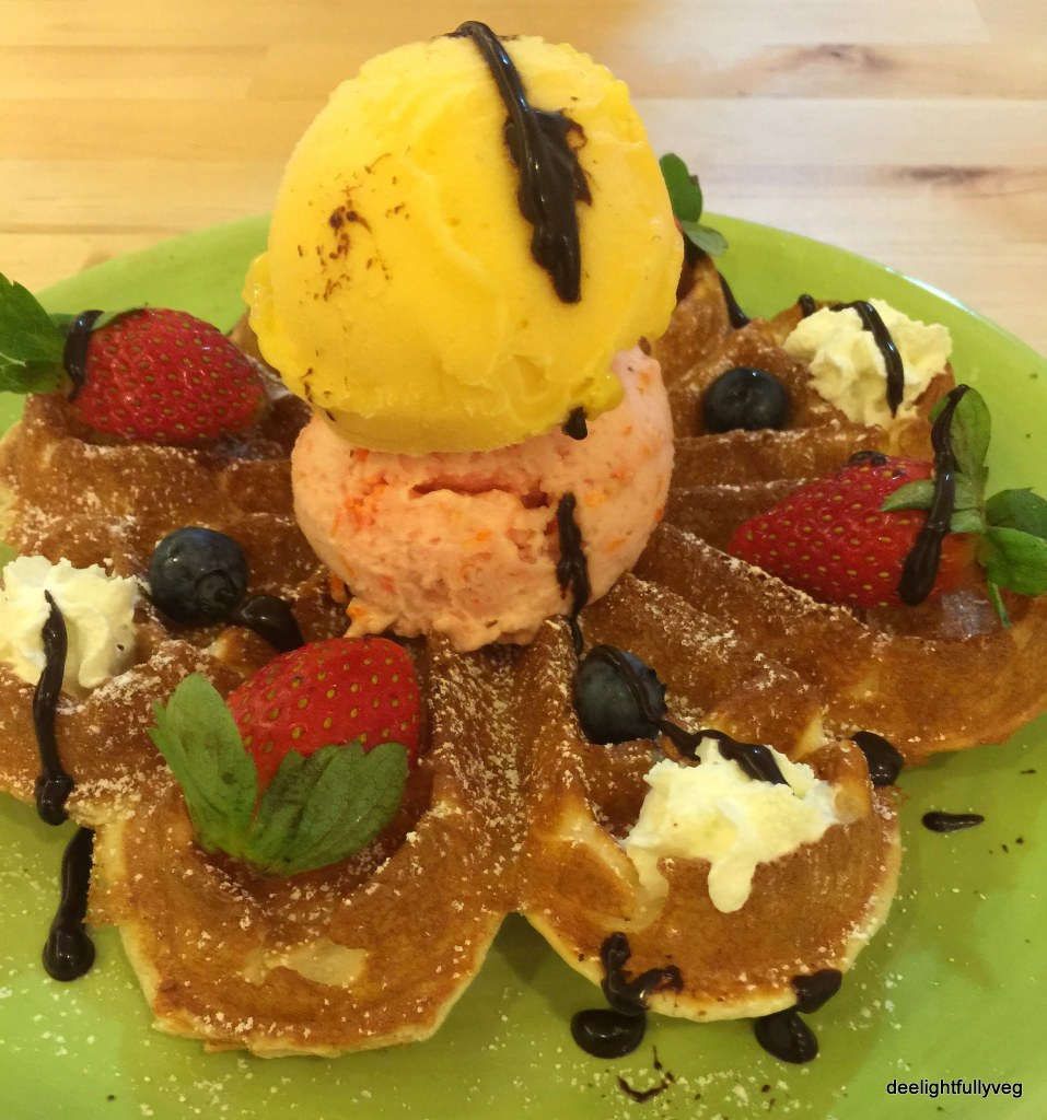 Blossom waffles with mango and cherry tomato