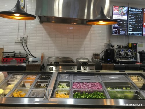 Pita pit toppings counter